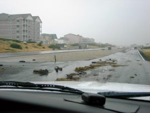 Debris washed over Ocean Shores Boulevard next to the Jetty.